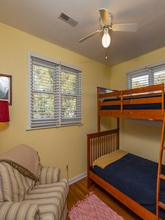Upper bunk room with full lower bed and single upper