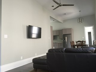 Living room with leather sofa and 50' tv