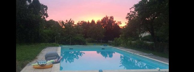Enjoy the sunset with a poolside glass of wine!