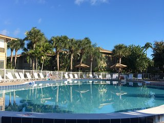 One week stay in updated condo pool view close to beach - only $992.34!