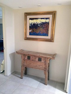 Niche by door to master bedroom featuring one of artist-owner's paintings.