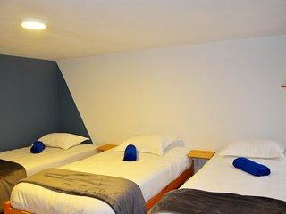 Habitacion tres camas sencillas
