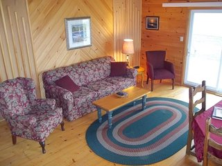 Duneside living room complete with comfortable queen sized sofa bed.