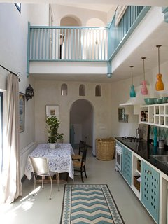 The double height kitchen and dining.