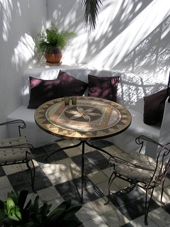 The Casita outdoor eating area under the palm tree.