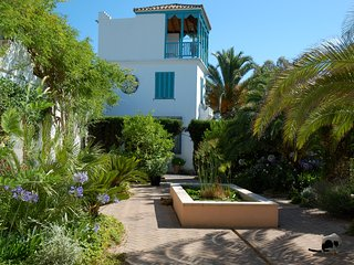 Romantic Moorish tower house set in exotic garden with stunning swimming pool