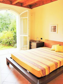 Bright & spacious master bedroom with double French doors the   reveal garden views