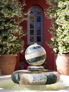 Mosaic fountain in shared garden.