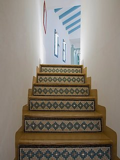 Pretty mosaic risers up to the first floor.