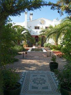 Casa Mosaica through the shared garden from the Casita entrance.