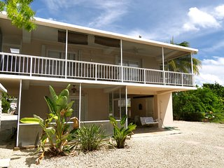 Lower Mat Canal Front Home w/ 60' dock and access to private beach on the bay!, Islamorada