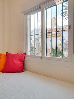 The third bedroom (on the second floor) has stunning views of Old Town Marbella.