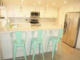 Remodeled 3 bedroom 2 bath First floor condo across the street from the Beach