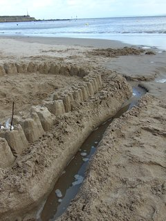 Building sandcastles on New Quay beach.
