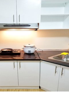 Fully equipped modern and safe kitchen with induction cooker, exhaust, pots, pans, rice cooker
