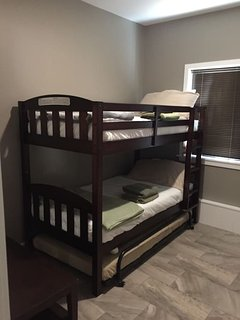 Bdrm #2 with a sturdy Bunkbed and a Trundle with a memory foam mattress