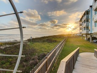 Oceanfront condo with a shared pool/hot tub and a private balcony, water views!