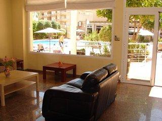 Lounge seating area overlooking pool