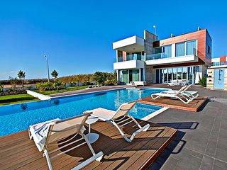 Pearl villa at beachfront development