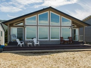 A true gem right on the sand with oceanfront views of Rockaway Beach, Oregon!