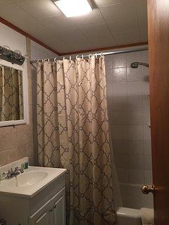 Main bathroom off of kitchen.