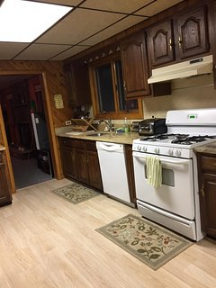 Kitchen with new granite counter tops and pergo flooring.  Everything you could need to cook or BBQ.