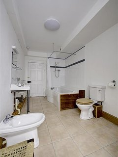 Family bathroom, with jacuzzi bath and shower over