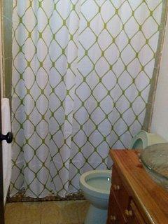 Large tiled shower in the bathroom