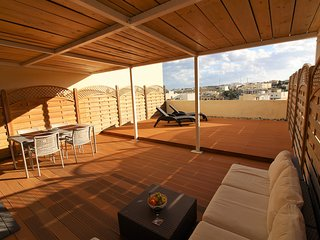 Open deck terrace with sunbathing and shaded area