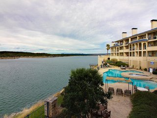 Lake front and upscale condo w/ shared pool, hot tub, sauna, and tennis courts!