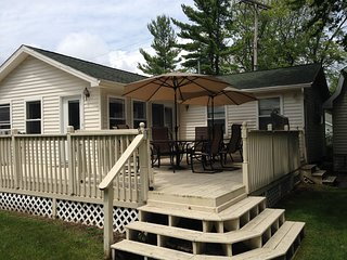 A modern family friendly home overlooking Lake Huron on a large sandy beach.
