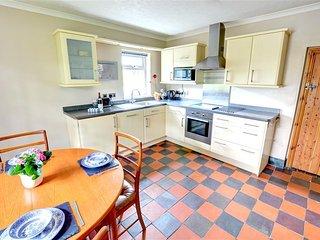 The tasteful modern kitchen boasts an original quarry tiled floor