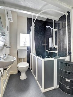 Wet room which has shower, WC and basin