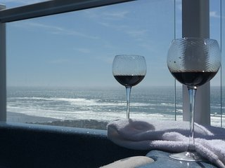 Enjoy The Sights And Sounds Of The Ocean From The Private Hot Tub