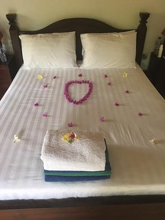 Egyptian cotton bedding with flower arrangement.