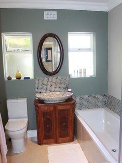 Main En-suite bathroom with shower and bath