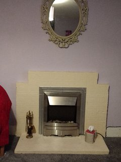 Picturesque fireplace with working electric fire
