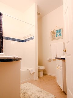 Bathroom off the hallway / surfer bedroom / kitchen area, separate vanities