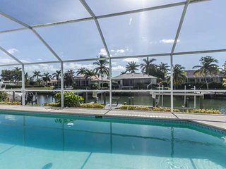 Luxury Canal Front Marco Island Pool/Spa Home with Boat/Jet Ski Dock & Direct Gu