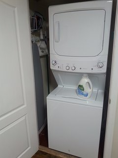 Washer/dryer, with detergent dryer sheets, iron/ironing board, and lint roller