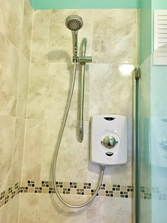 Electric over bath shower.