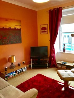 Living room has TV, with freeview, DVD player & sound bar. Selection of DVD's, books & games.