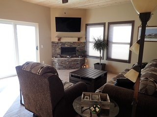 living room with queen size sleeper sofa and recliner