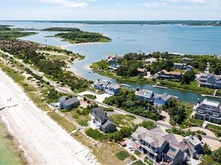 Spectacular waterfront home with boat dock & private beach in a gated community