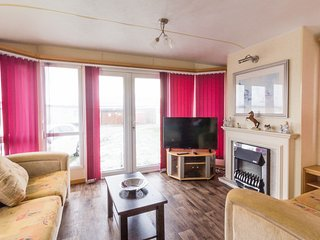 Lounge area hire this caravan for you family holiday at California Cliffs.