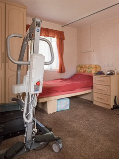 Larger bedroom, 2 single caravan beds, portable hoist