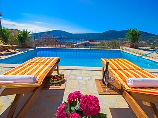 A luxury, A/C, 2 bedroom, stone villa, garden, pool and stunning sea views