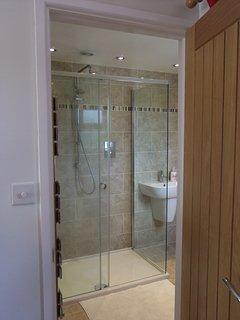 En-Suite shower room with large shower enclosure and deluge shower head