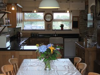 Family kitchen/Dining room with induction hob and double oven. Granite work tops and slate floor