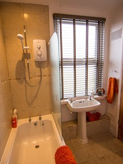 Bathroom: bath with electric shower over